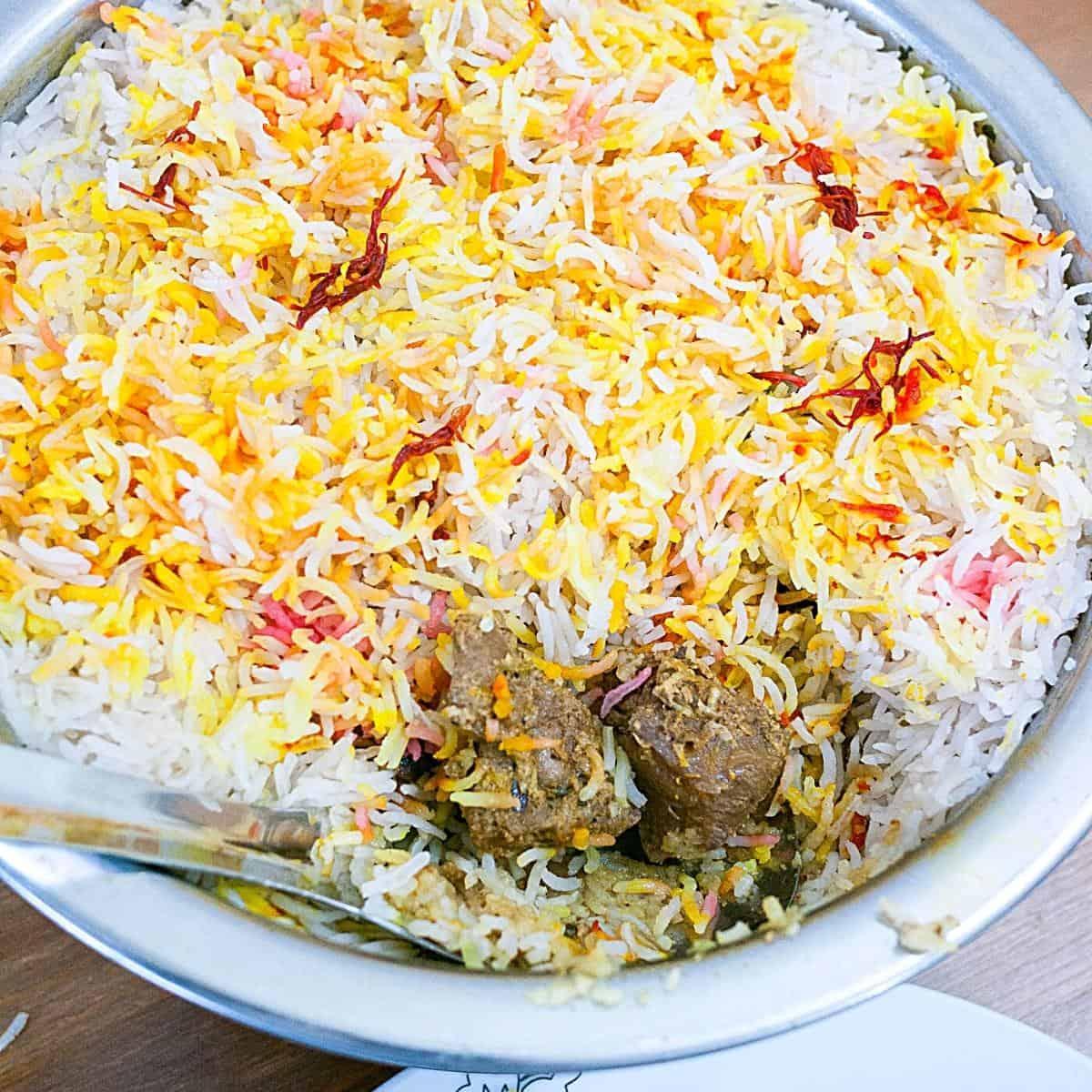 Biryani in a pot with lamb.