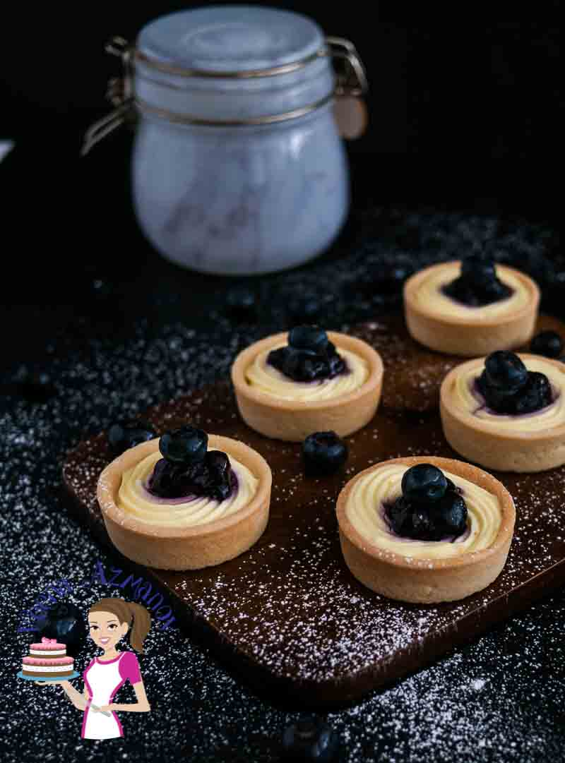 These blueberry cream cheese tarts are ready in 20 minutes and are perfect when you need to make a quick fancy dessert. This simple, easy and effortless recipe takes advantage of ready to use tart shells that cut preparation time by half and make entertaining a breeze with cream cheese and blueberry filling that just melts in the mouth.