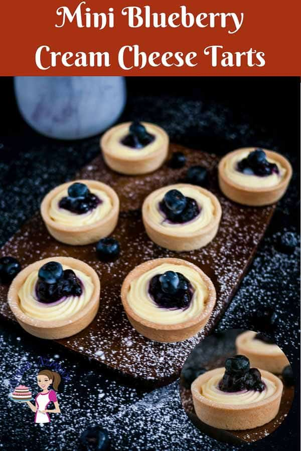 A Pinterest optimized image for Mini blueberry cream cheese tarts with cream cheese base and blueberry filling in a shortcrust pastry