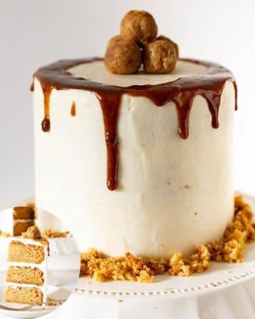 A butterscotch cake on a cake stand.