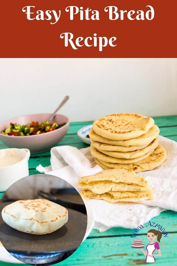 A Pinterest optimized image for Easy Pita Bread Recipe showing a pile of homemade pita bread surrounded by salad, tahini and hummus.