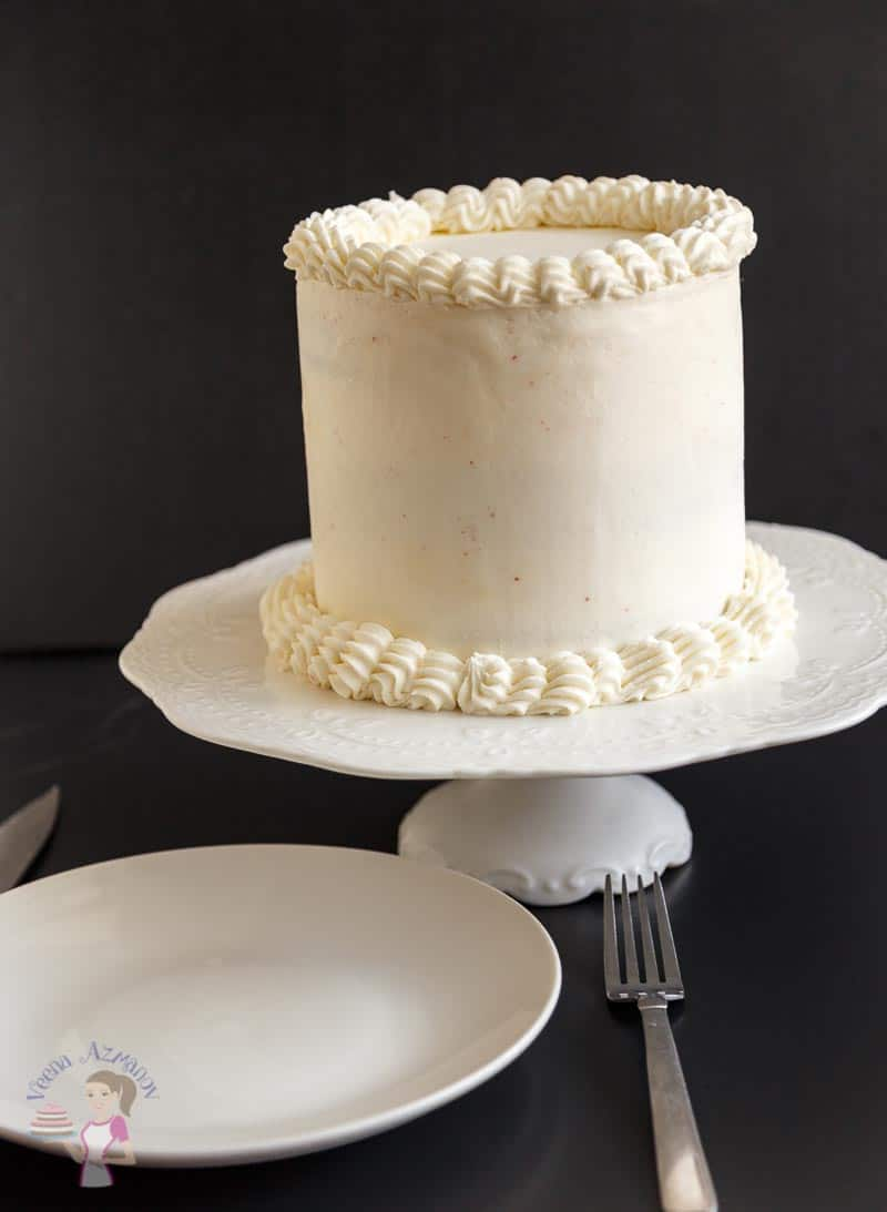 An uncut cake show casing the Cream Cheese Frosting on this classic red velvet cake made from scratch