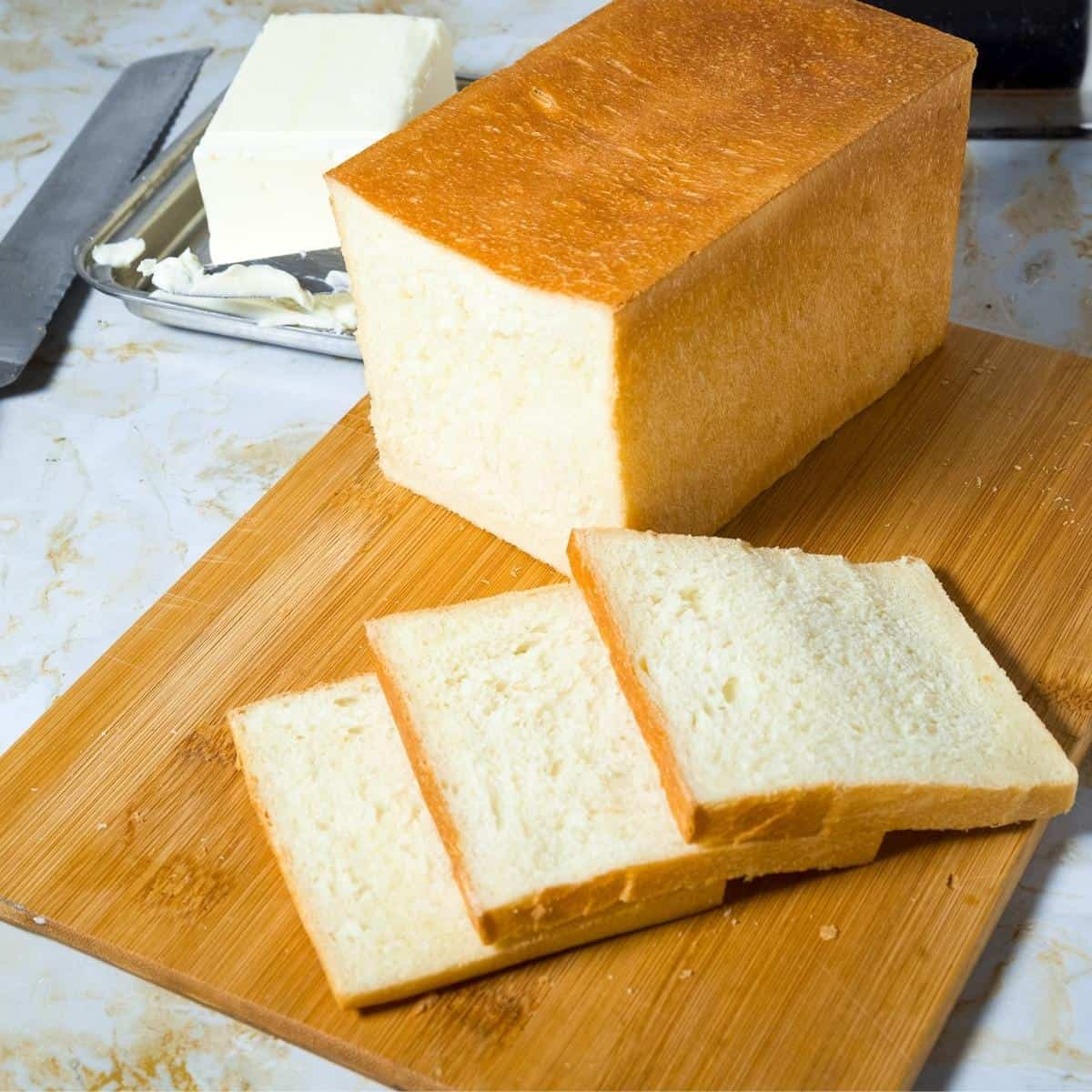 Sliced pullman bread on a wooden board
