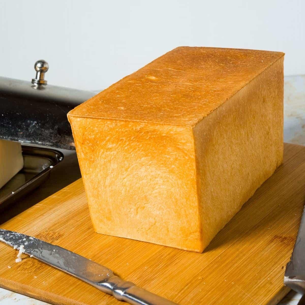 A pullman sandwich bread on a wooden board