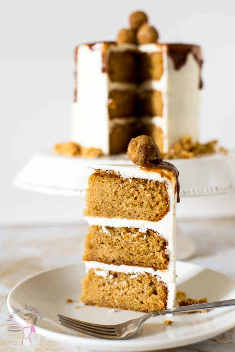 An Image optimized for social sharing for this Butterscotch cake made from scratch and frosted with Swiss meringue buttercream then topped with more butterscotch sauce.