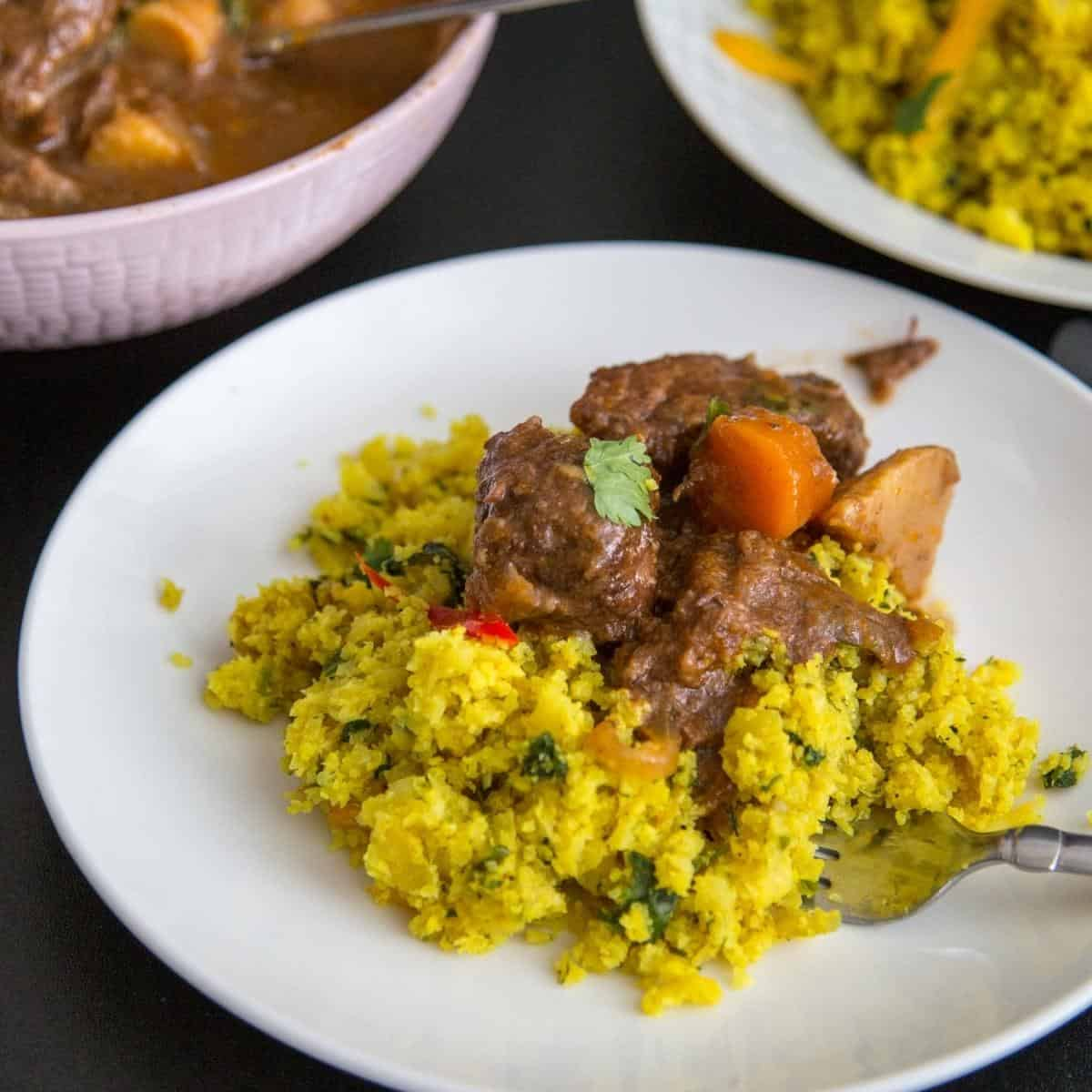 Cauliflower rice pilaf with turmeric in a bowl