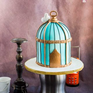 A birdcage cake makes a fun cake for a vintage celebration such as a 50th or 60th milestone. This vintage birdcage cake tutorial shares how to make this cake simple, easy and effortlessly with detailed instructions, the recipes as well as a video tutorial from start to finish. Use my tips to ensure you have a perfect flawless cake whether you have a beginner or advanced cake decorating skill level