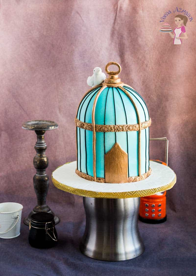 A vintage look for my vintage birdcage cake tutorial with a gum paste bird and metallic gold finish.