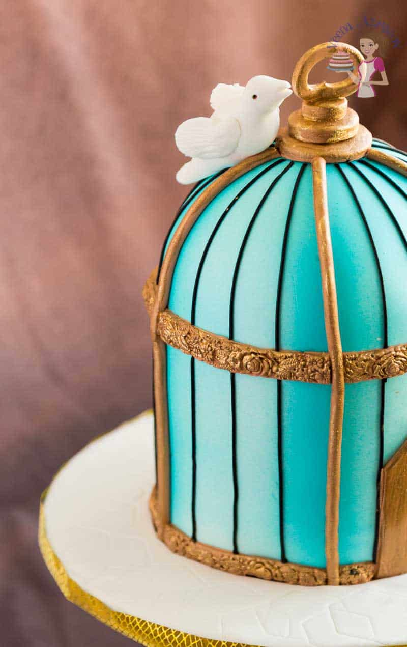 A closer view of the bird on this Vintage birdcage cake tutorial showing how to create this cake from start to finish on a video tutorial