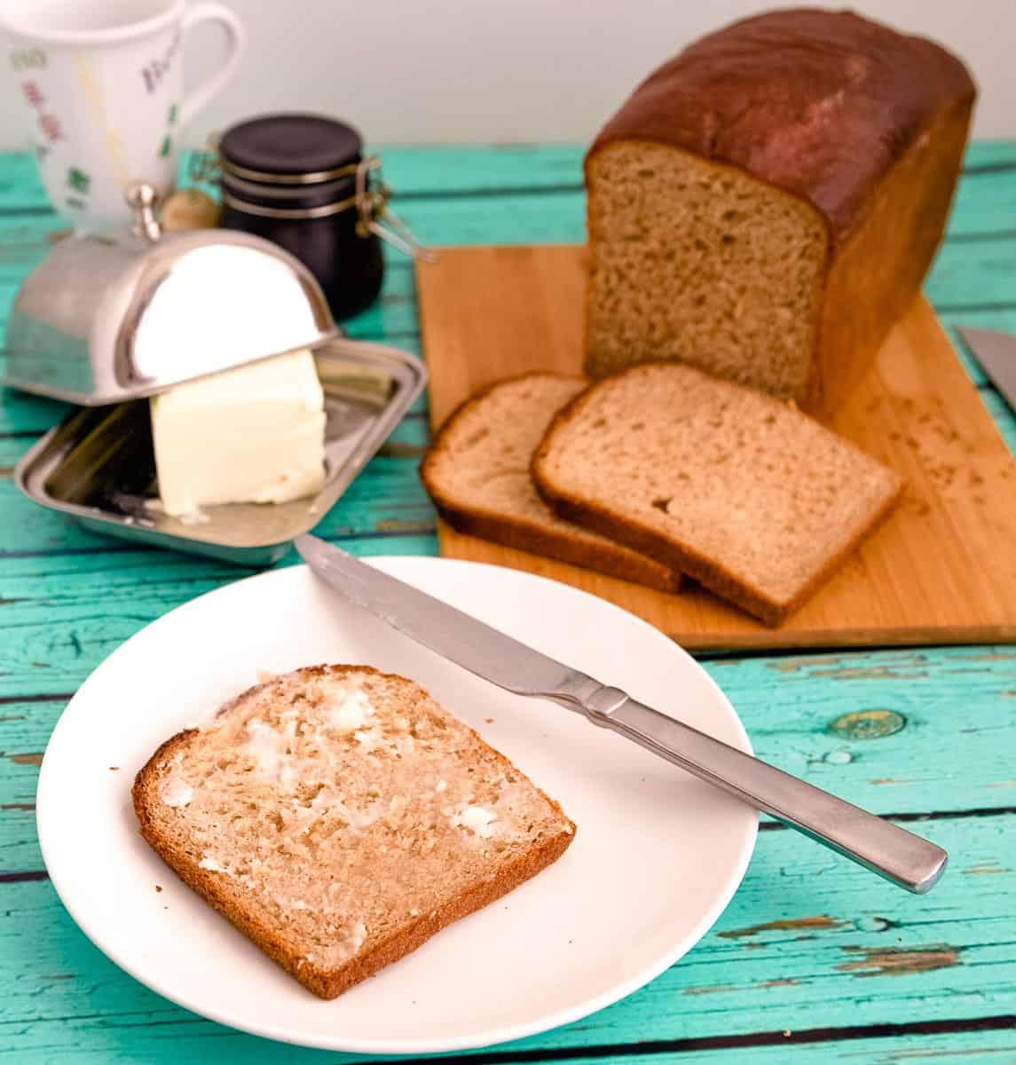 A buttered slice of sandwich bread.