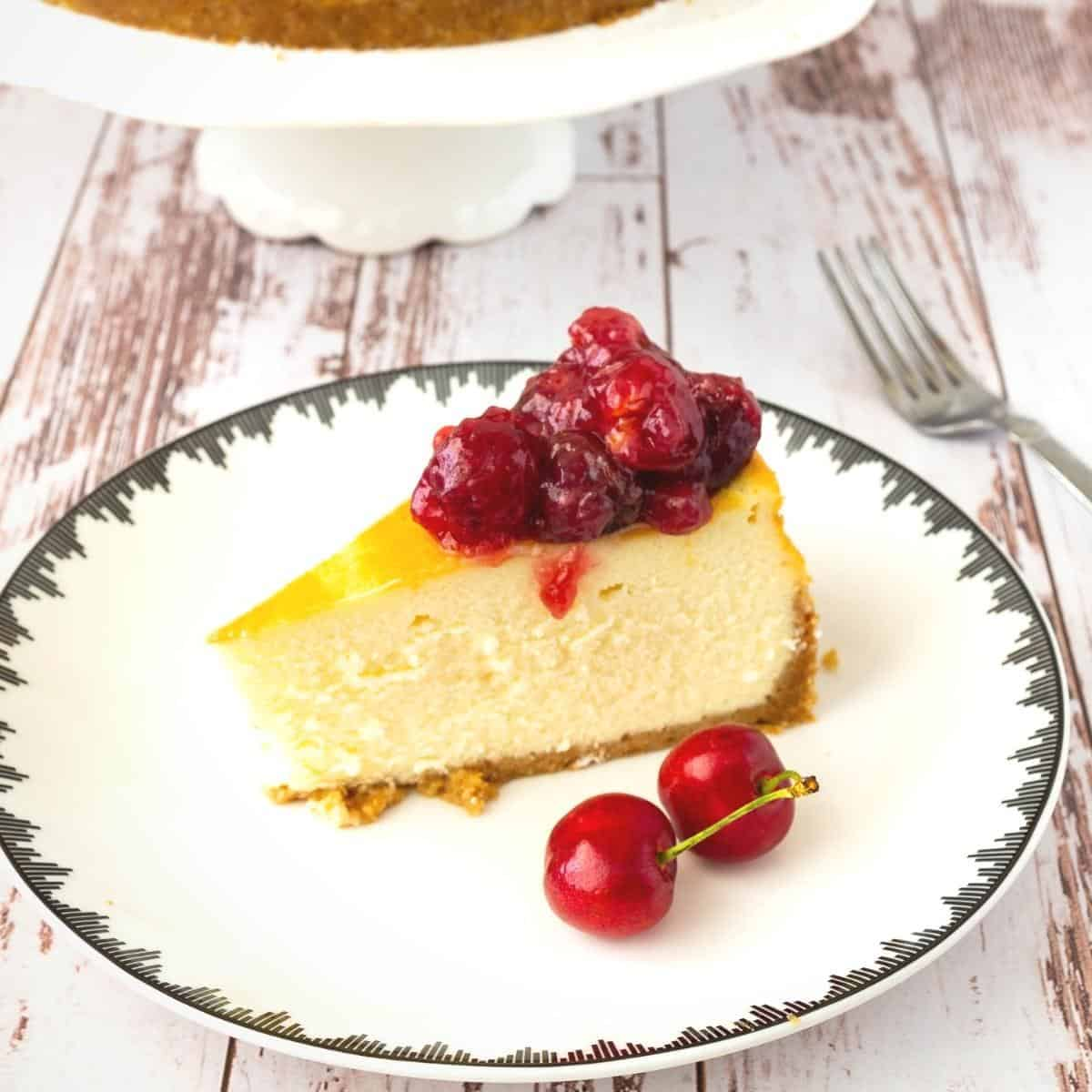 A slice of cheesecake with cherry topping.