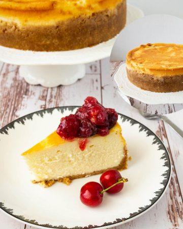 Slice of cheesecake with cherries.