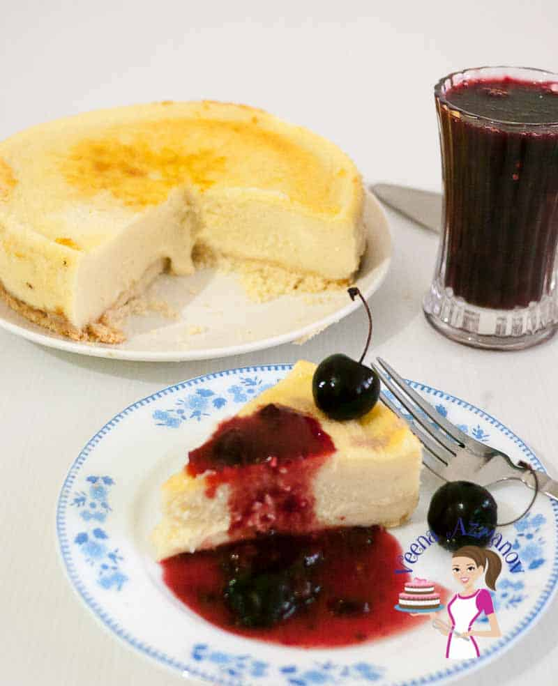 Front view of a slice of cherry cheesecake made with fresh cherry topping baked to perfection with a custard based filling