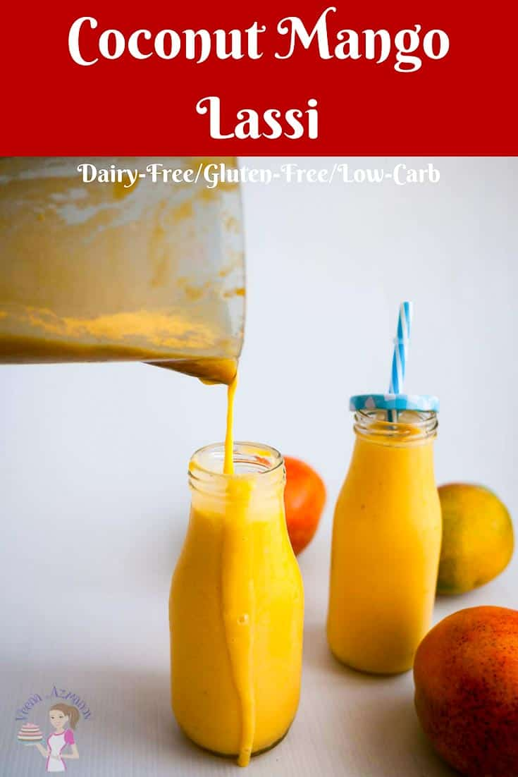 A Pinterest Optimized Image for Coconut Mango Lassi featuring a pouring shot of the drink from the pitcher into a milk bottle.