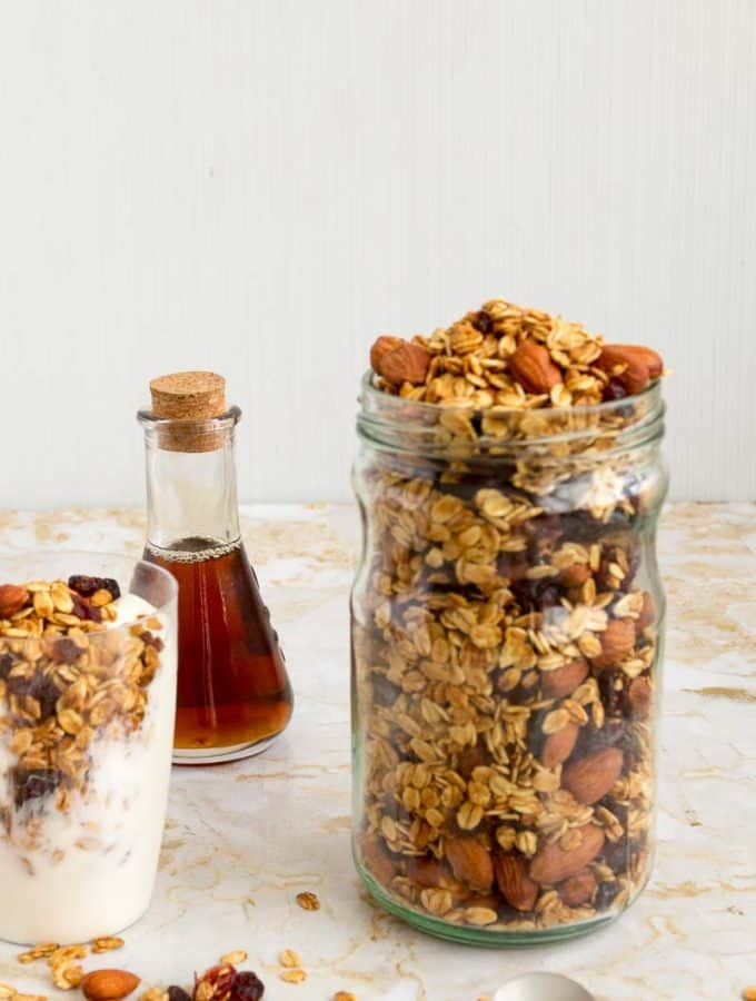 Start your day with a bowl of nutritious and healthy granola. This simple, easy and effortless recipe for homemade cranberry almond granola takes five minutes to prepare and less than thirty minutes to bake. With natural sweetness from cranberry and honey accompanied by toasted almonds make this an absolute treat any time of the day when you need a quick snack or breakfast at dinner.