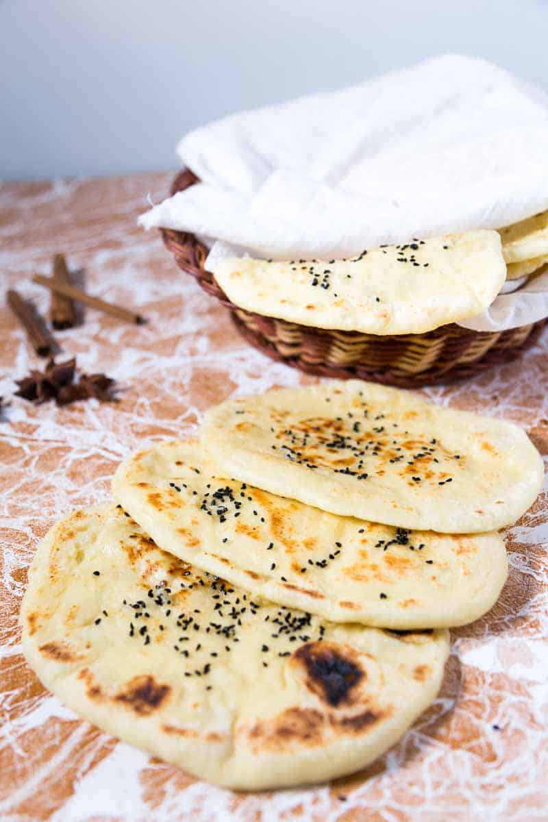 A Pinterest Optimized image for Nigella Garlic Butter Naan recipe a variation on the Classic Indian Naan Recipe