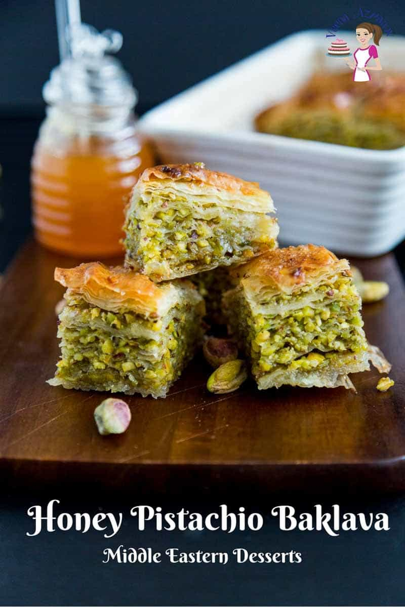 A Pinterest optimized image for honey pistachio baklava. A close up of three squares with layers of green pistachios.