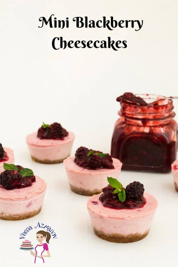 An Image optimized for social sharing for this Baked Mini Blackberry Cheesecakes a custard baked cheese filling baked in a water bath and topped with more blackberry sauce.