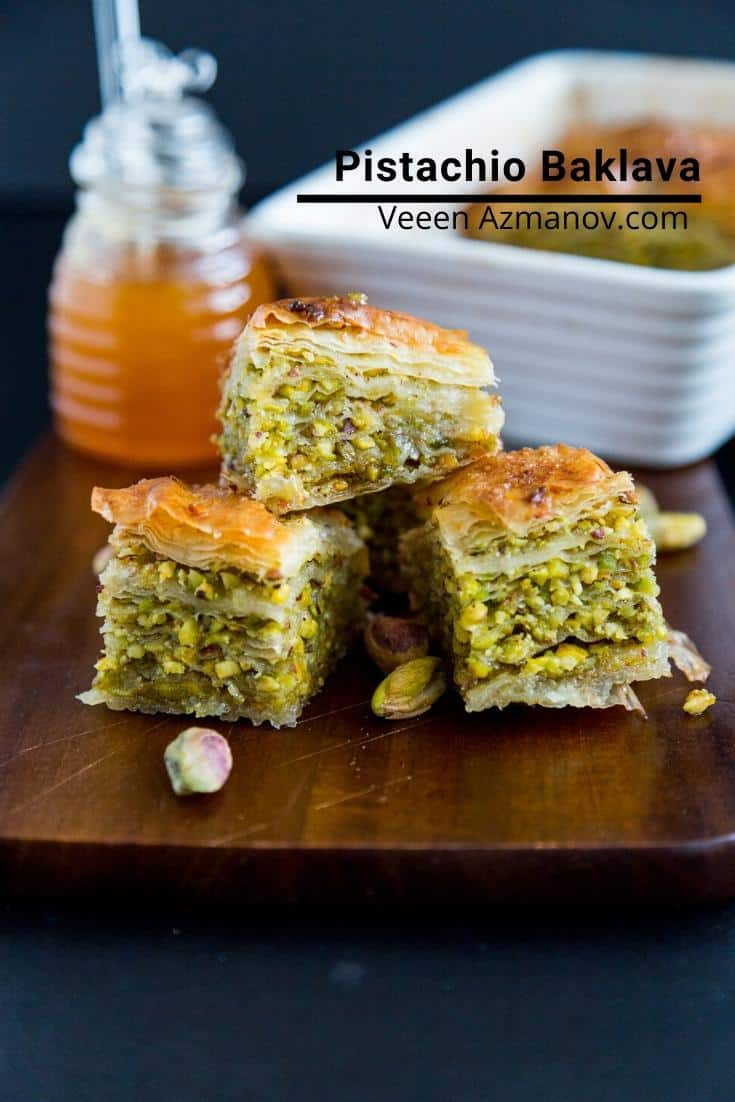 Three squares of pistachio baklava on a table.