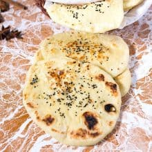 Stack of naan on the table.