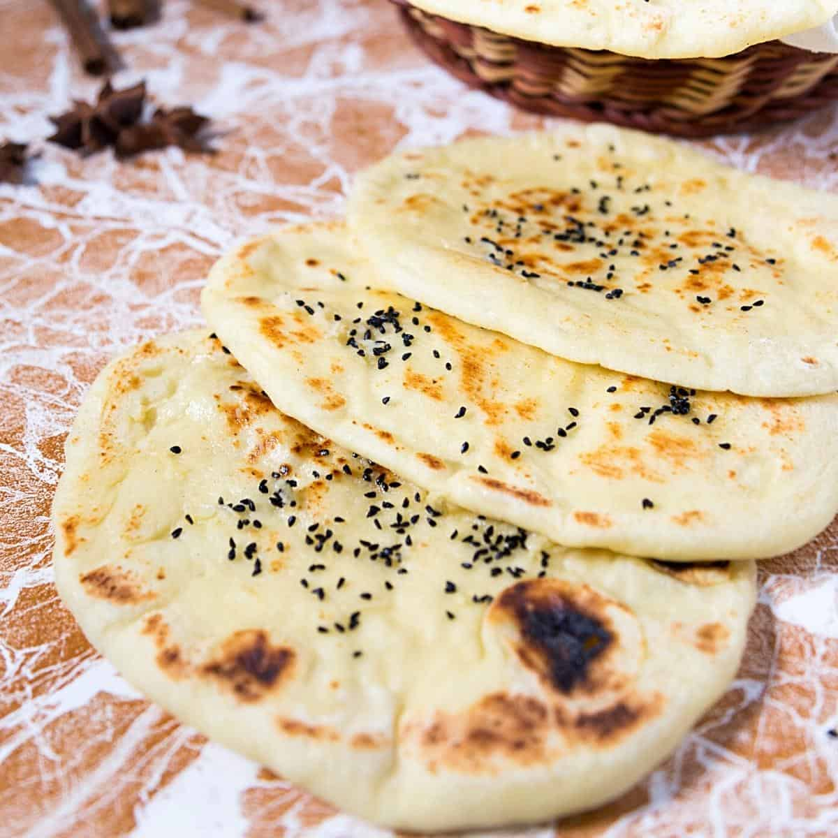 A stack of naan on the table.