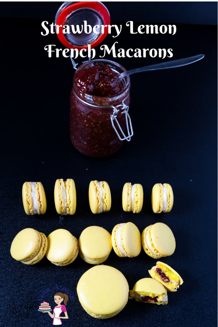 A Pinterest Optimized image for these strawberry lemon French macarons featuring strawberry jam and lemon macarons in place on a black background