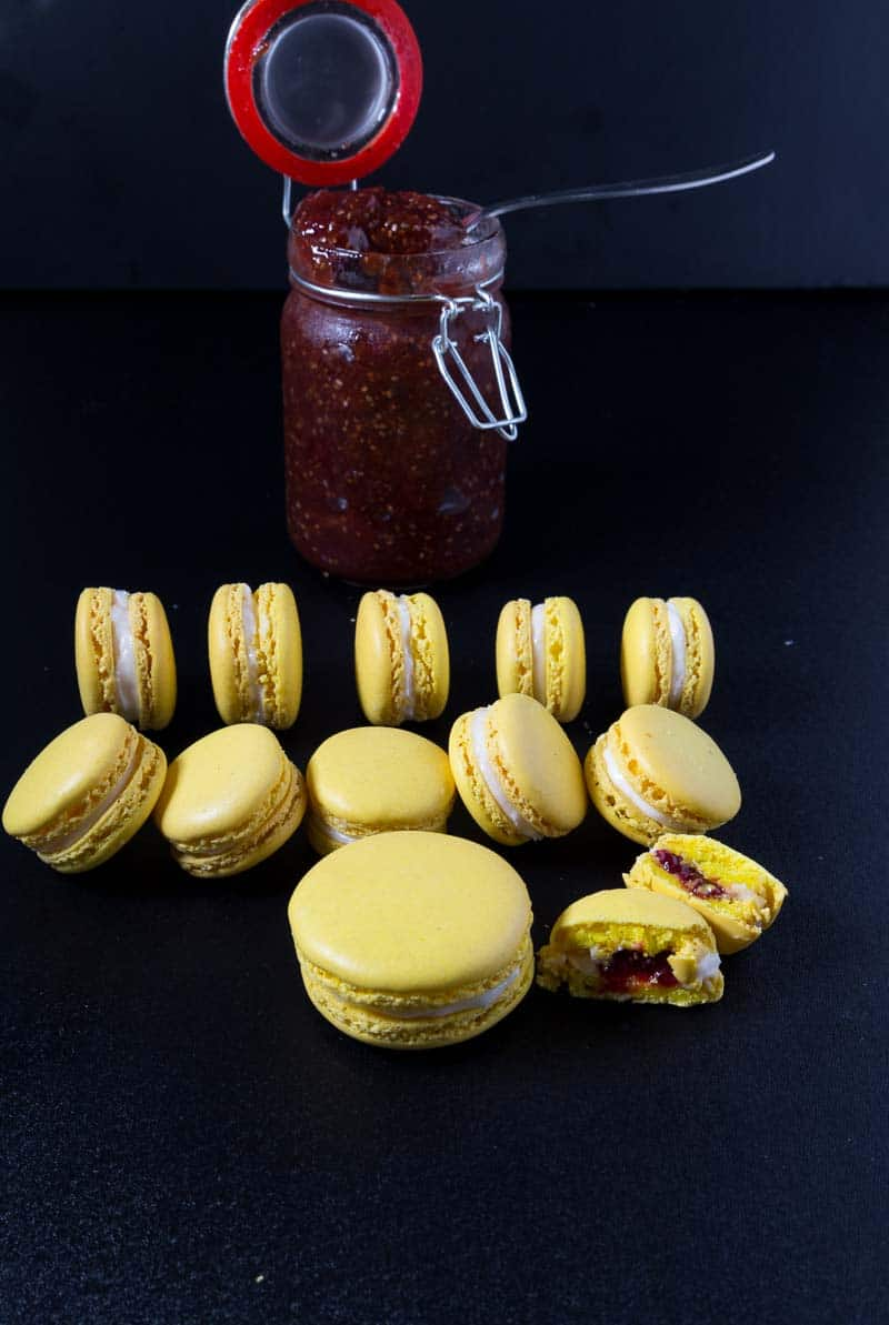 A Pinterest optimized image for these strawberry lemon French macaron featuring my chia seed strawberry jam and Swiss meringue buttercream