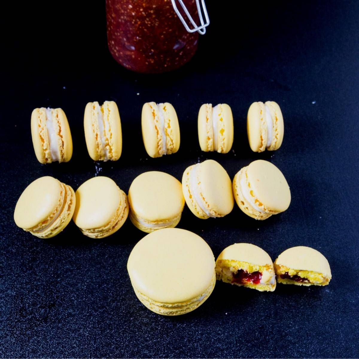A stack of lemon macarons on the black board