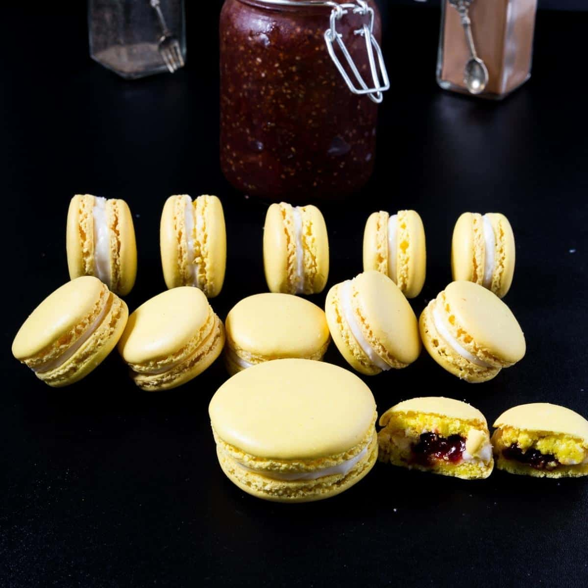 yellow French macarons on a black board