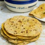 A stack of chapatis on a table.