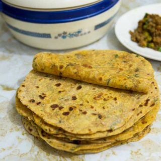 This whole wheat sweet potato chapati or flatbread is so versatile you can have it for breakfast, lunch, and dinner. This simple, easy and effortless recipe makes the softest sweet potato flatbread ever. Combined with onions and herbs means you can have it on its own or as a bread with your main course.