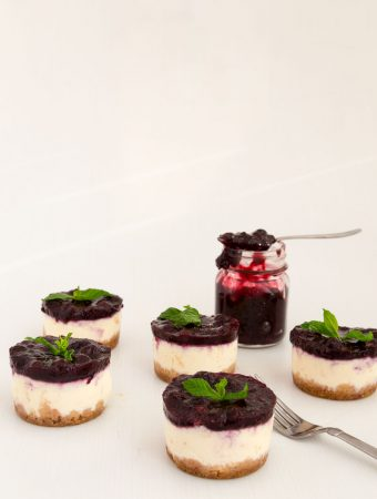 Nothing beats cheesecake for dessert any time of the year. This simple, easy and effortless recipe for mini blueberry cheesecakes is perfect for entertaining or when you need the mini versions of the classic. A custard-based cheese batter baked to perfection then topped with luxurious blueberry filling is a perfect mini treat at the end of any meal.