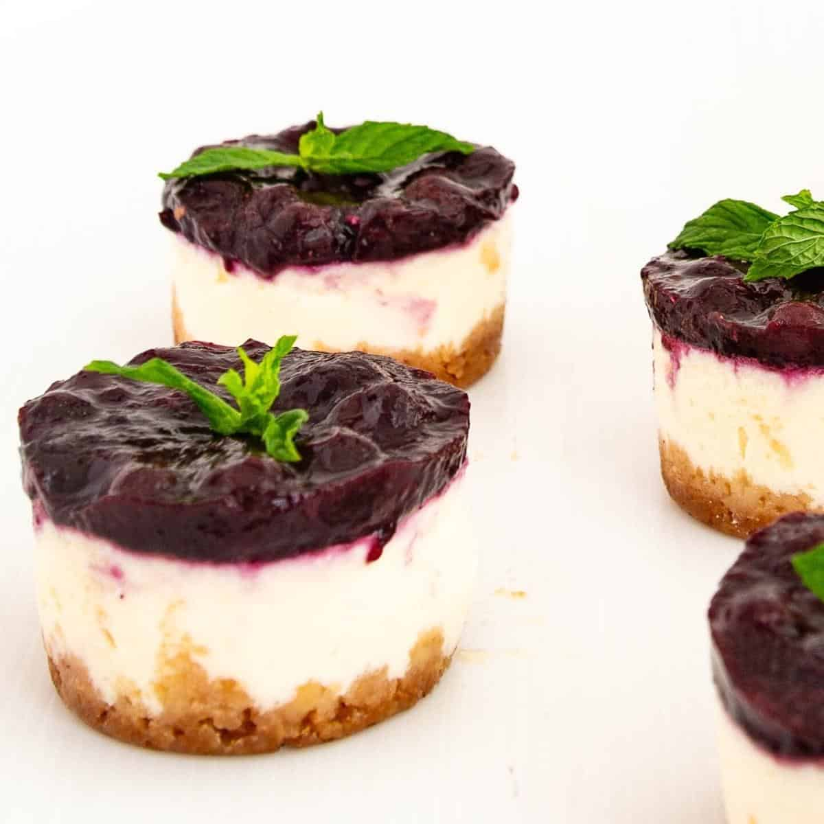 Mini cheesecakes on the table.