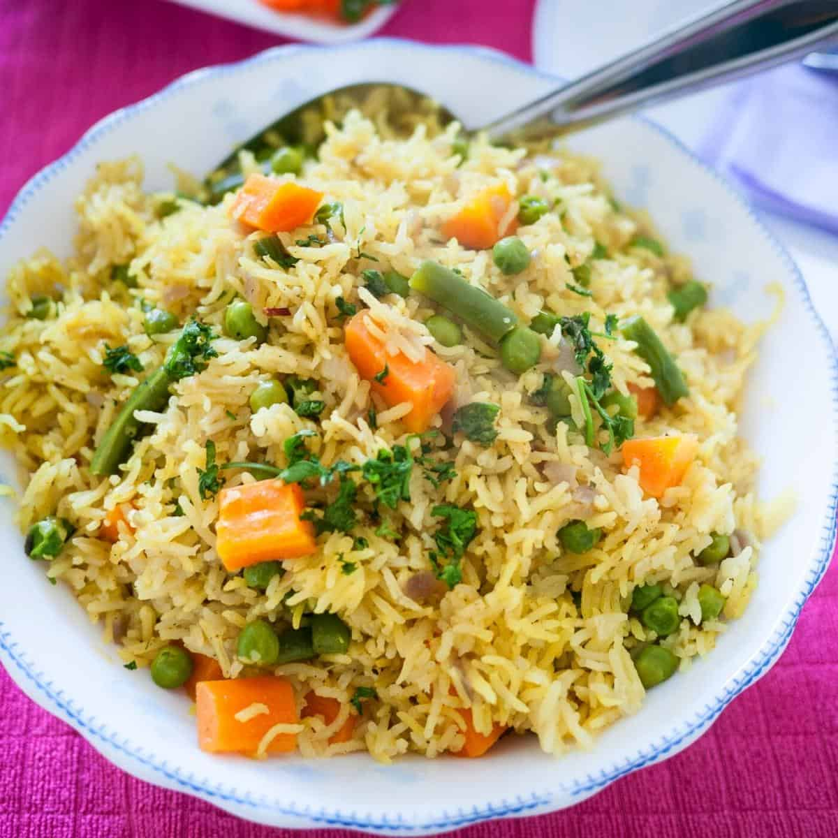 A bowl with vegetable rice