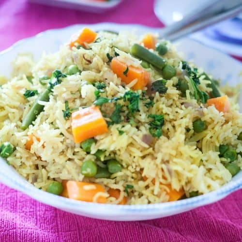 A bowl with rice and veggies