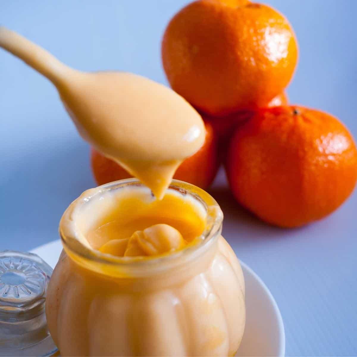 A jar with orange curd filling