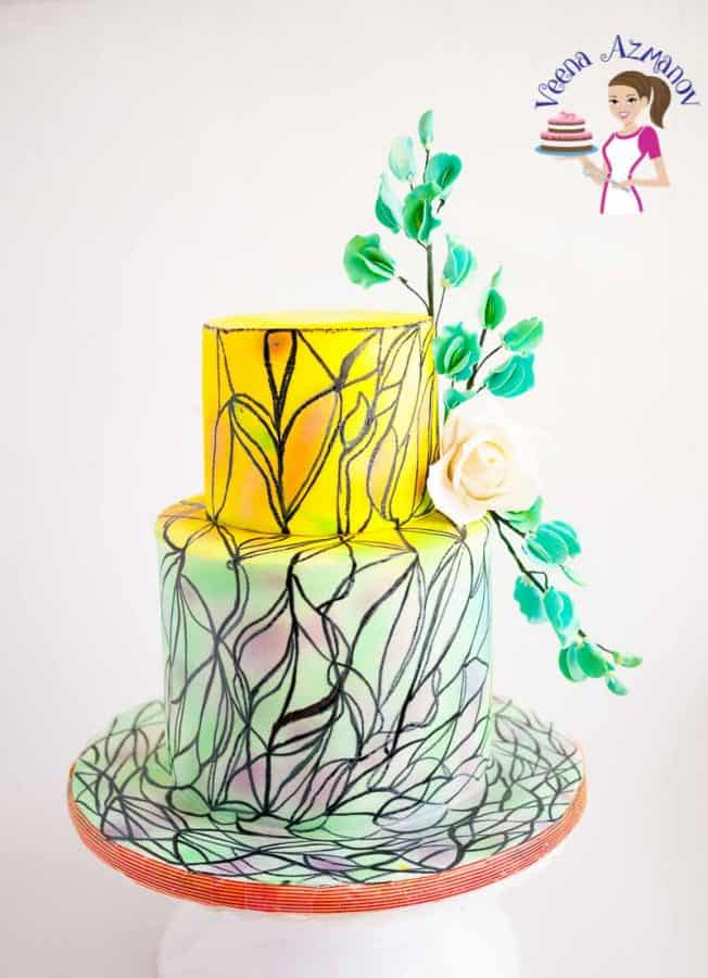 A cake decorated in a stained glass design.