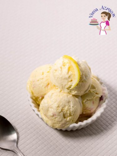 4 scoops of lemon ice cream in a bowl.