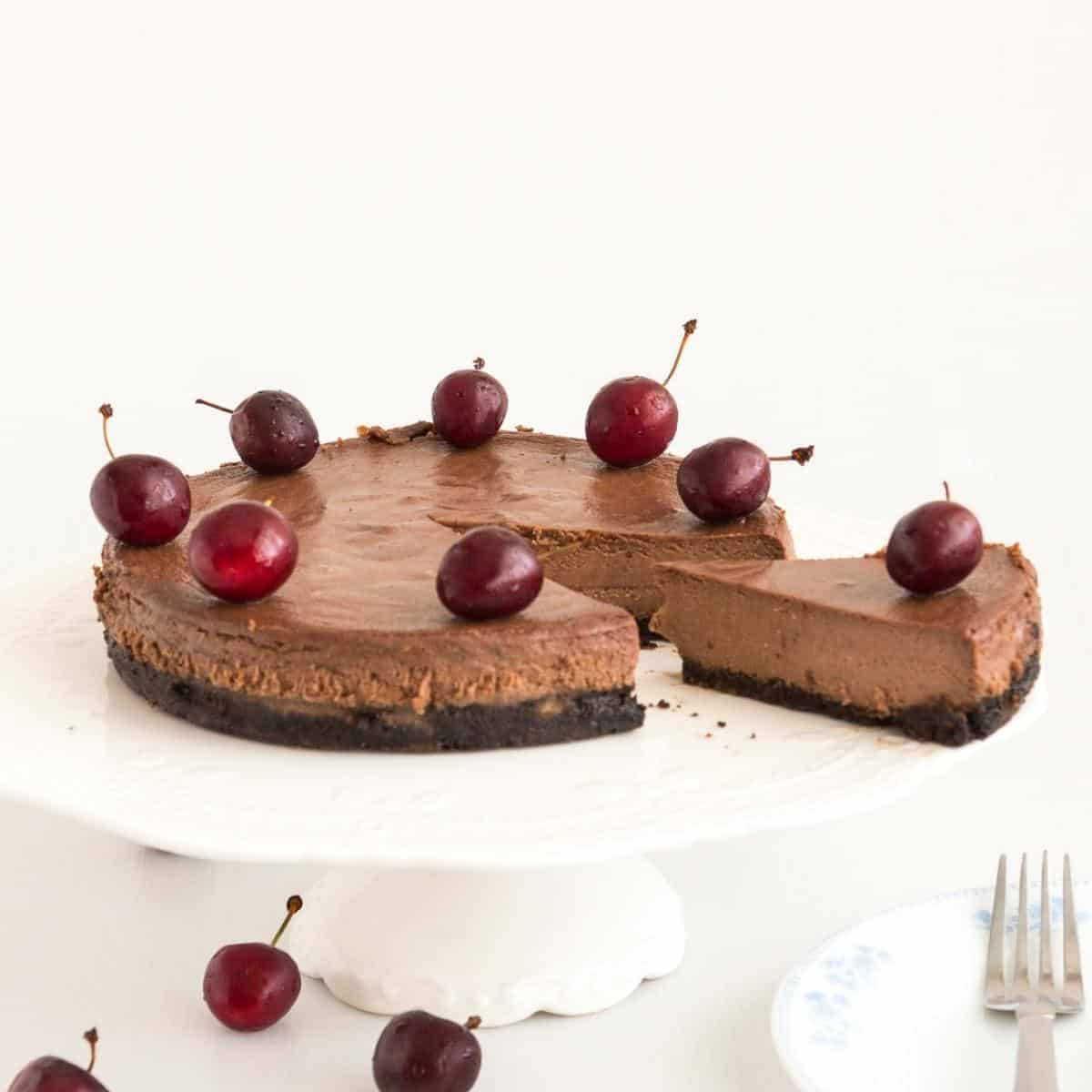A sliced cheesecake on a cake stand.