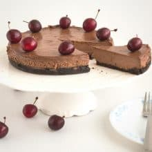 Cherry cheesecake on a cake stand.