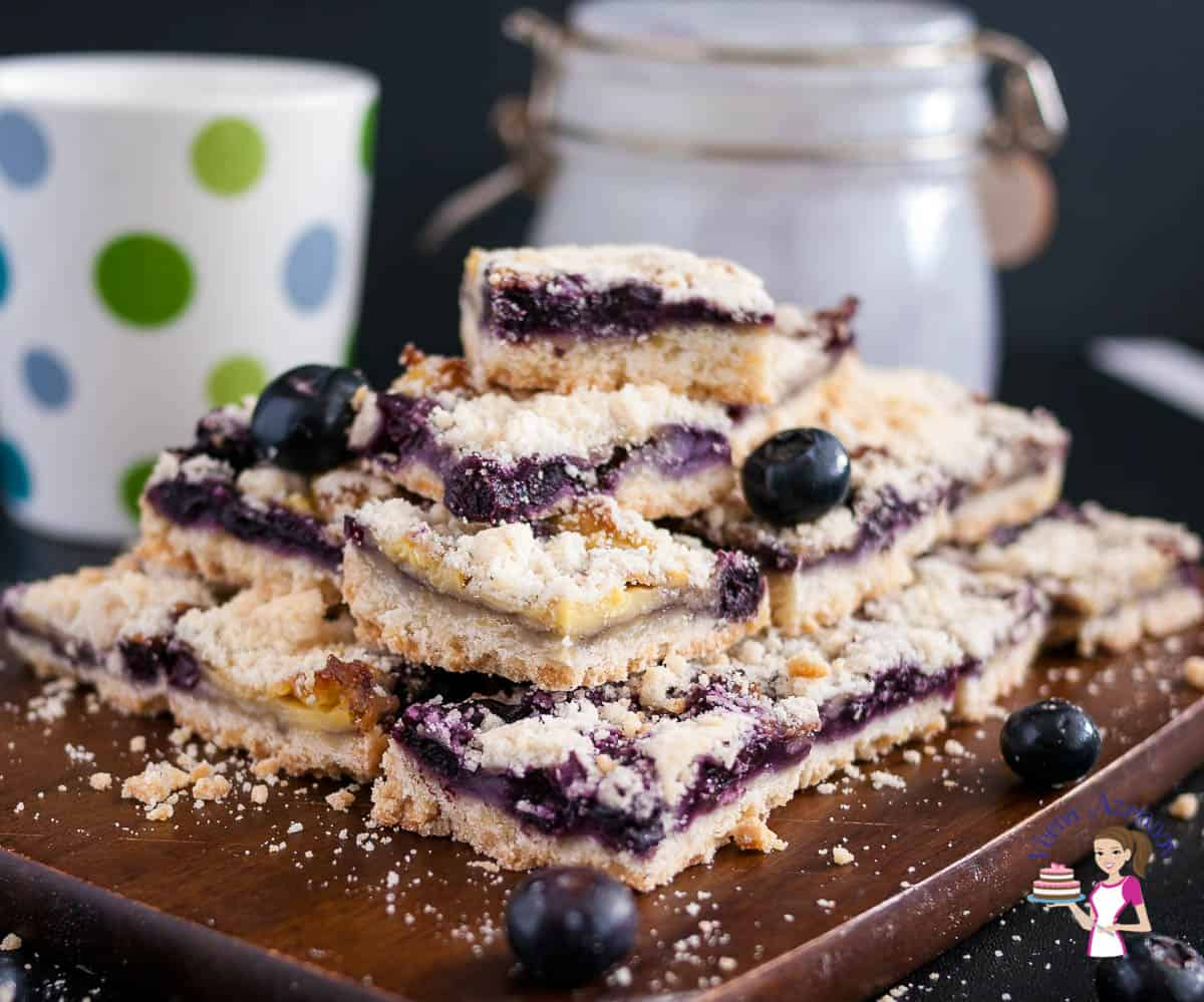 Blueberry bars on a wooden baord