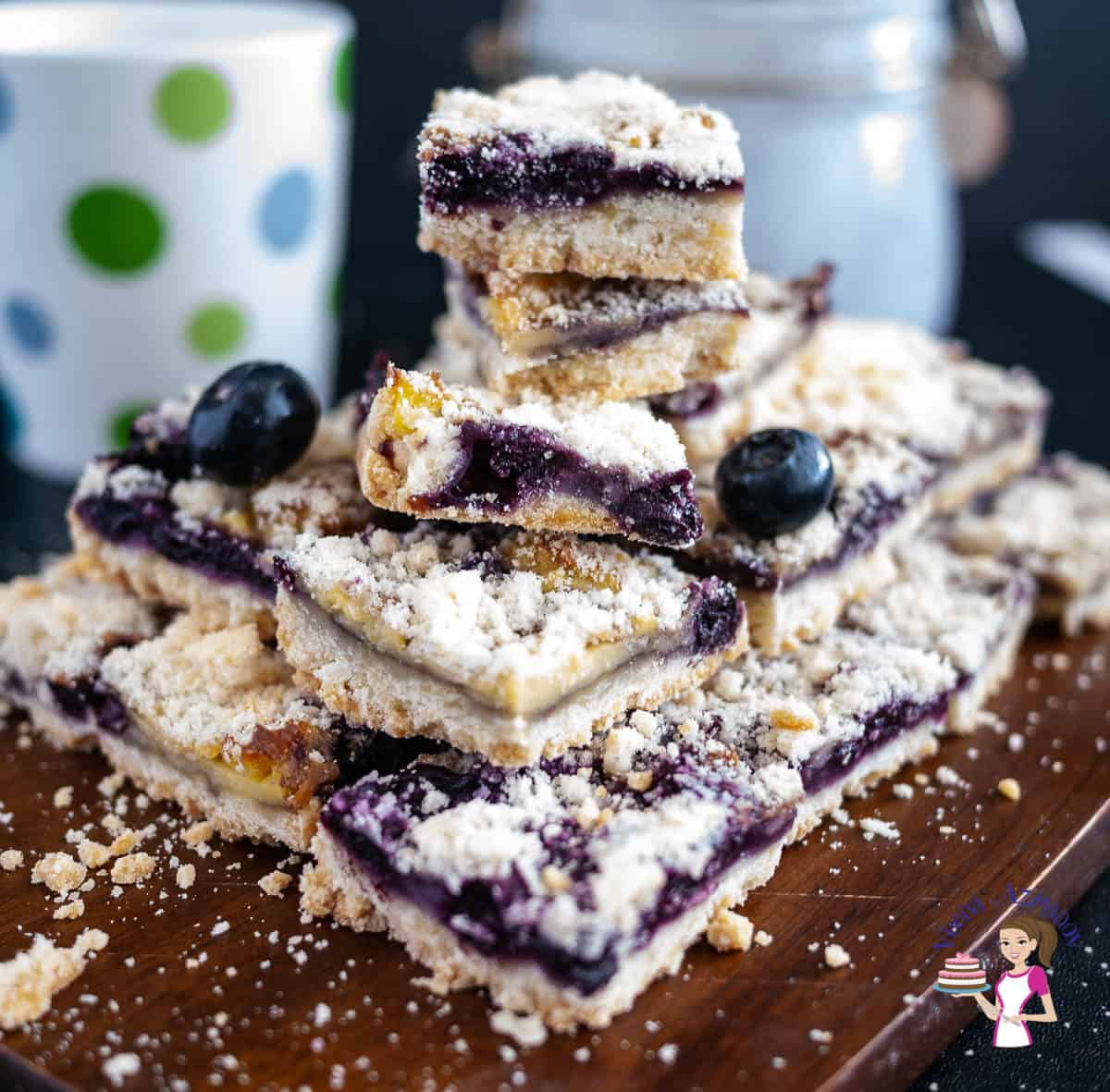Stack of blueberry bars on a wooden board
