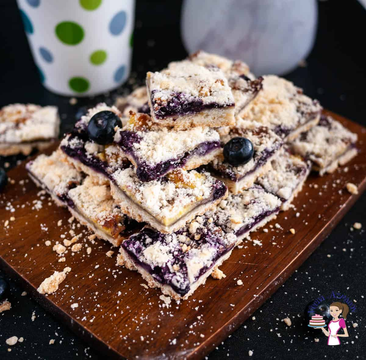 Blueberry bars on a wooden board