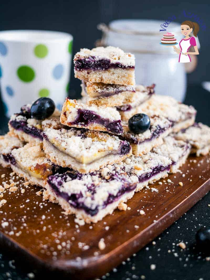 An image optimized for social share for these blueberry cream cheese crumb bars aka blueberry squares made with buttery crust, a cream cheese based blueberry filling, and a crisp crumb top that just melts in the mouth.