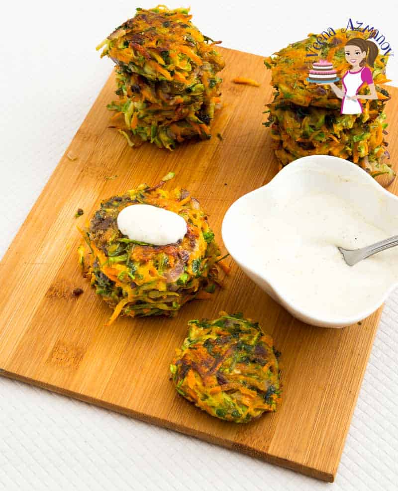 Carrot zucchini patties on a wooden board.