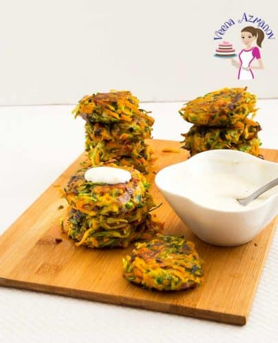 An image optimized for social sharing for these zucchini fritters. Made with Carrots in the mix these carrot zucchini fritters are pan fried with no choose to keep them light and refreshing