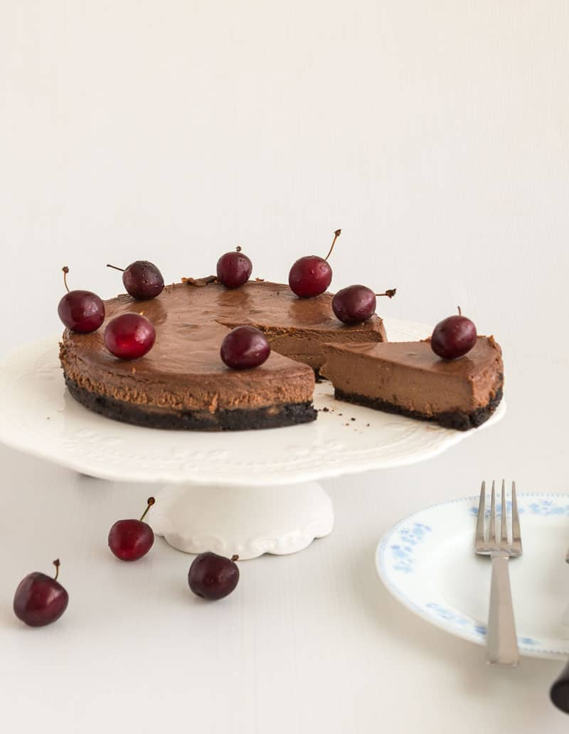 Chocolate cheesecake on a cake stand.
