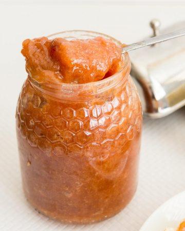 A jam jar with spoon.