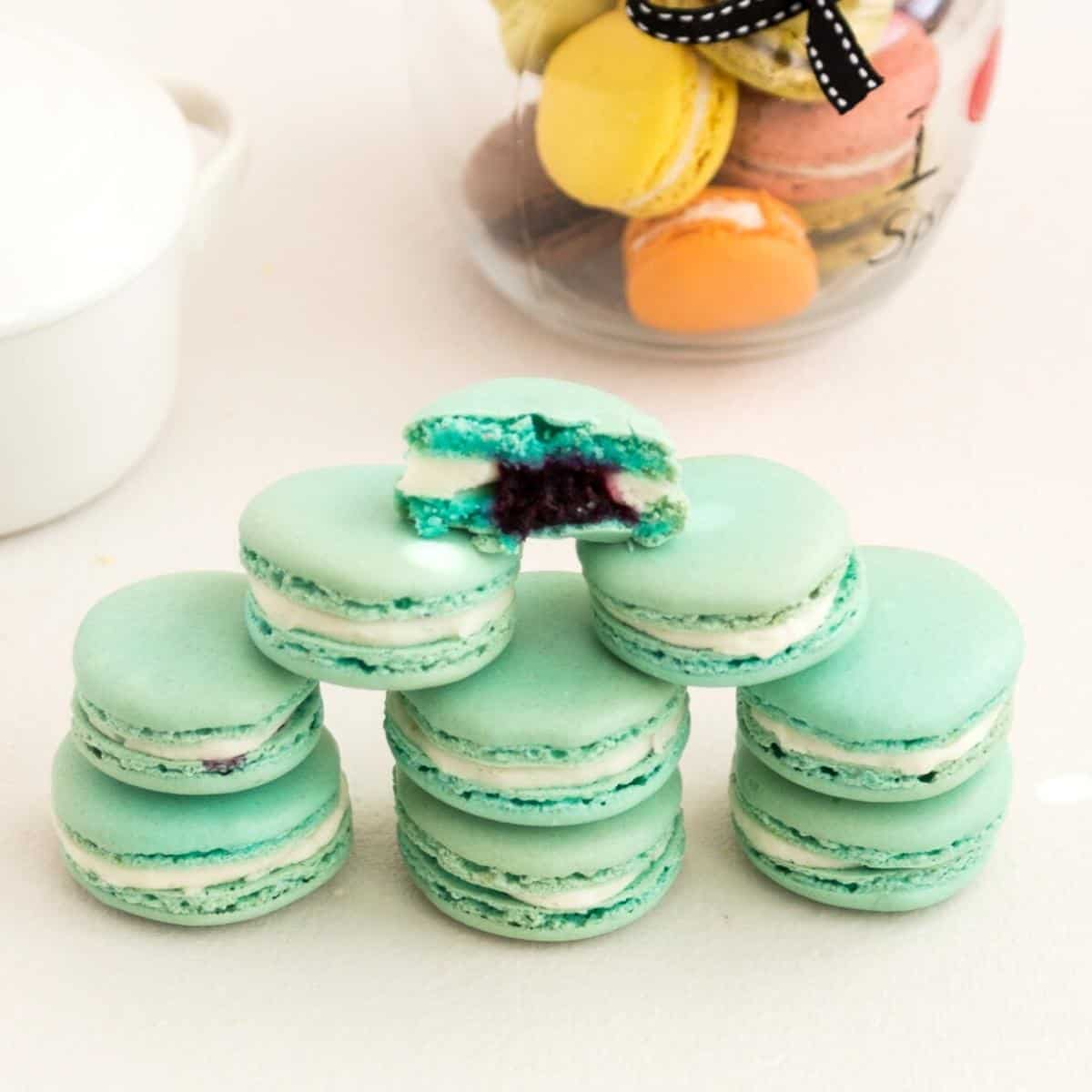 A stack of macarons on a table