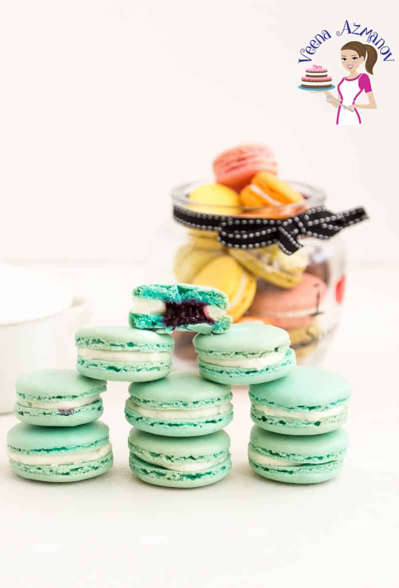 An image optimized for social media share for these blueberry macarons filled with blueberry filling and Swiss meringue buttercream.